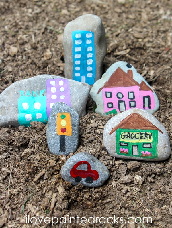 Paint  tiny town on rocks to add to your fairy garden or for your kids to play with