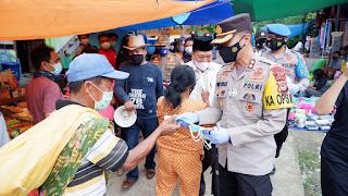 3000 Masker dan 1000 Hand Sanitiser Dibagikan Polres Tator, di Pasar Pondingao