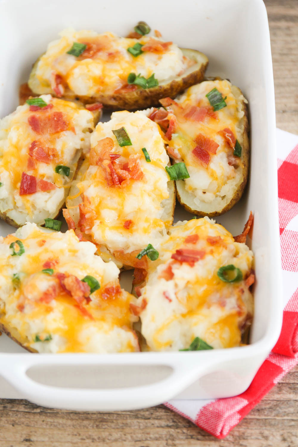 These loaded twice baked potatoes are packed with bacon, cheddar, and sour cream. They're incredibly delicious and so easy to make!