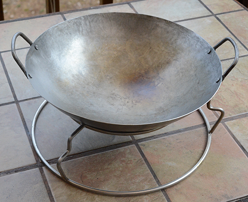 The Woo rig from Ceramic Grill Store serves as a great wok stand when you invert it.