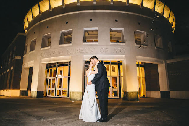orlando museum of art bride and groom kissing outside of m