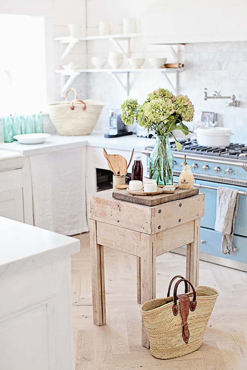 Farmhouse style kitchen with French antique butcher block work table. Dreamy Whites.