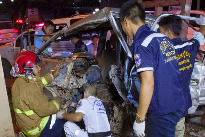 Photo Credit:  Anne Barker.  Sebastien Perret and Vientiane Rescue volunteers try to extract a young driver trapped and injured in a smashed truck.