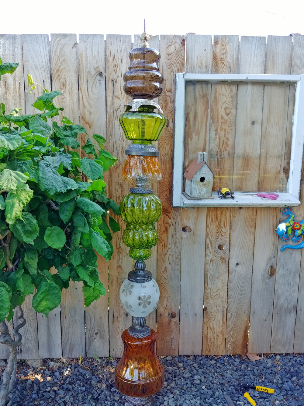 make a totem pole out of glass lamp globes