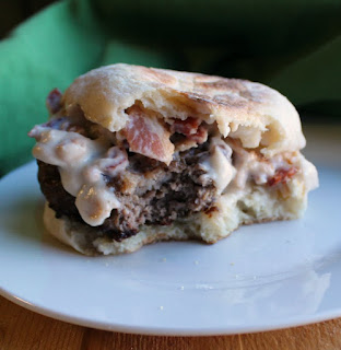 smothered breakfast burger with bacon gravy on english muffin