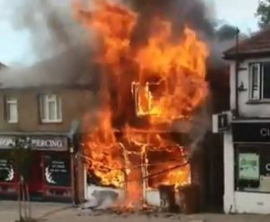 Major road closed in Cheam due to building engulfed in flames