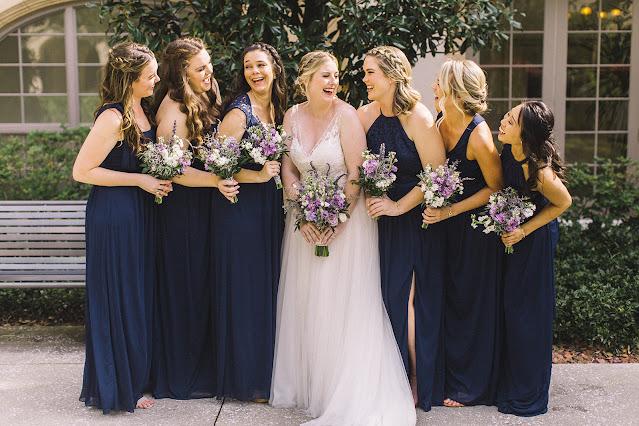 bride and bridesmaids taking photos