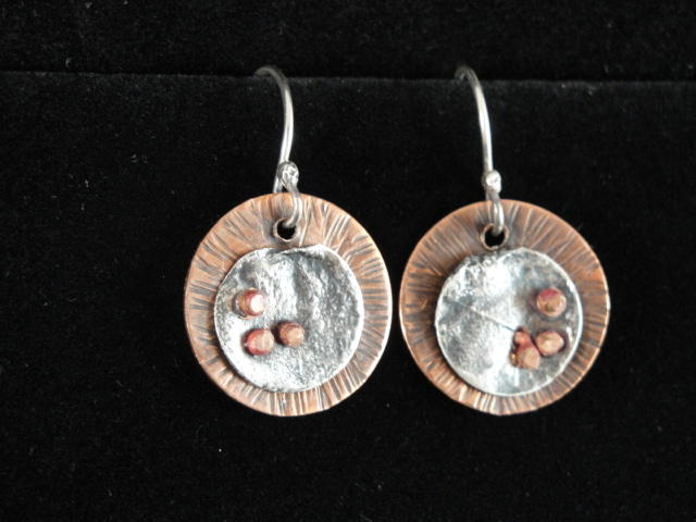 2a76f28e4 Here's a pair of earrings I made with the discs of reticulated silver, over  copper. The rivets are copper, heat treated to turn pink.