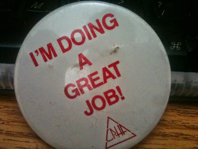 "A pin that reads, ""I'm Doing a Great Job!""."