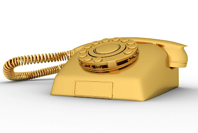 golden, old fashioned phone