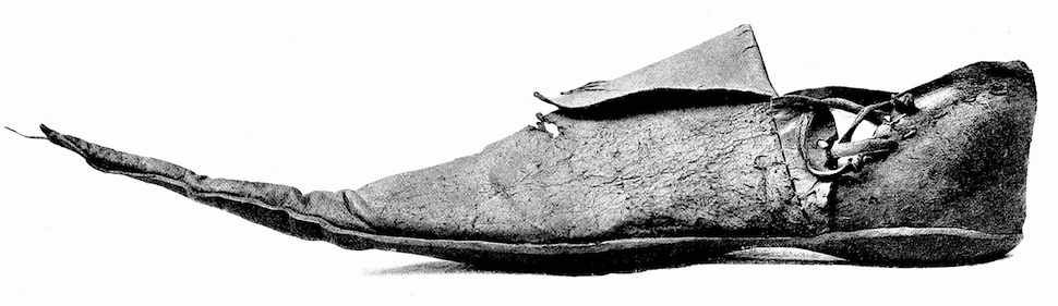 a photograph of a 1400s English shoe, in long pointed leather