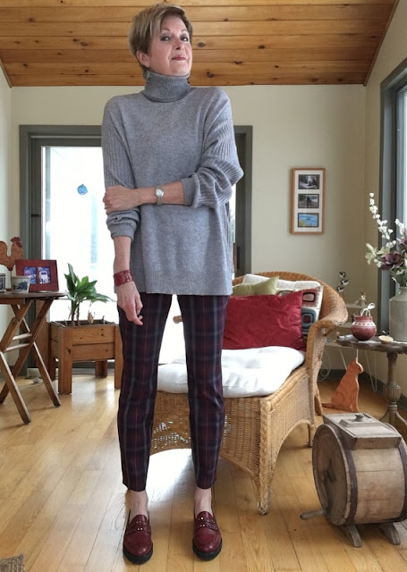 woman in grey turtleneck, burgundy plaid pants, and burgundy loafers