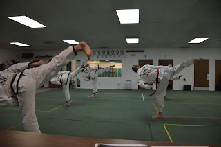 Students doing a side kick at martial arts classes at Colorado Taekwondo Institute