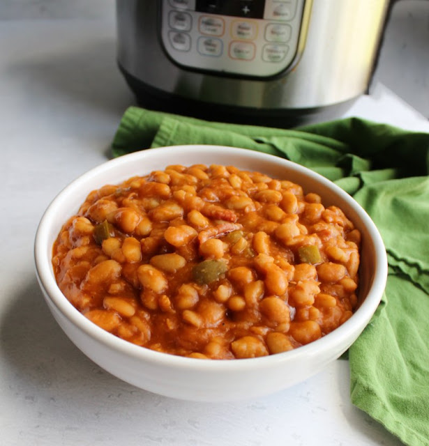 big bowl of maple bacon baked beans in front of instant pot