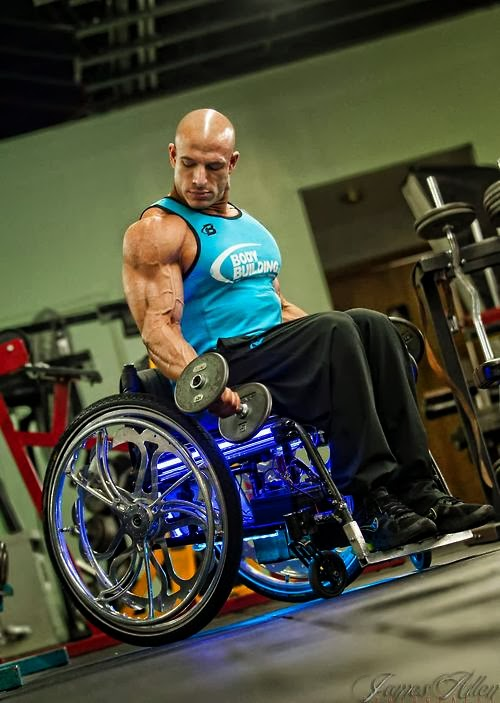 Man with muscular upper body, lifting hand weights, while sitting in purple wheelchair, lit up underneath