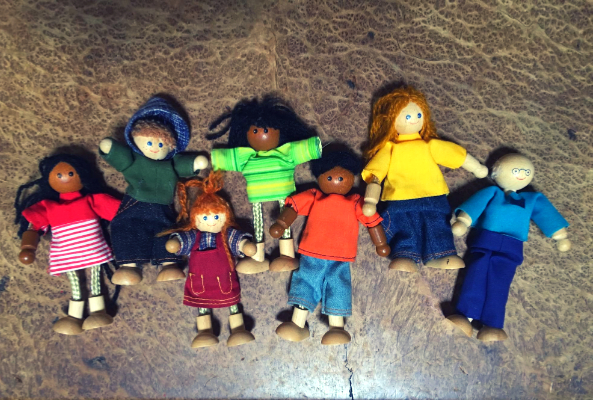 wooden dolls with brown skin, white skin and black skin