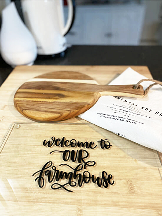glass cutting board with tea towel on counter