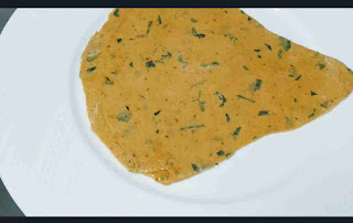 Rolling Triangular Methi paratha