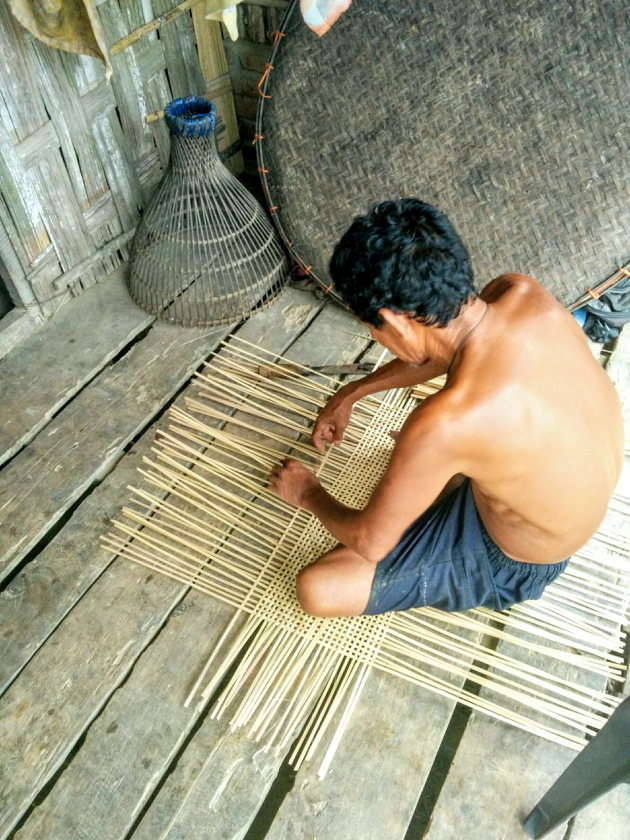 Elderly Mishing tribal man weaving a basket, Assam