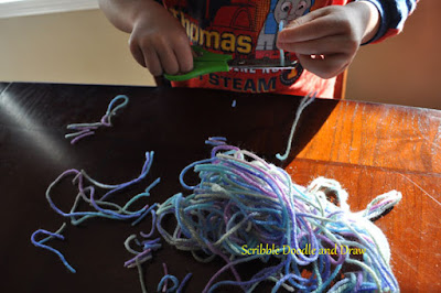 Practice cutting monster hair to build fine motor skills