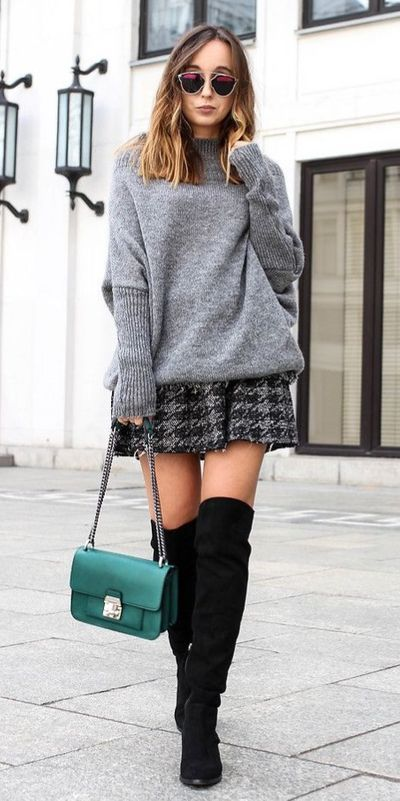 Fall in love this winter season with these cozy sweater outfits. Winter Fashion via higiggle.com | oversized grey sweater with mini skirt | #sweater #winter #fashion #skirt