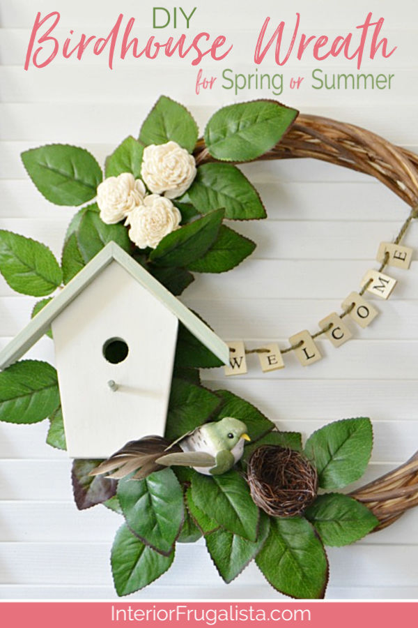 A unique welcoming DIY birdhouse wreath with farmhouse style for Spring And Summer that's easy on the wallet made with thrift store and dollar store finds. #springwreath #birdhousewreath #grapevinewreathidea