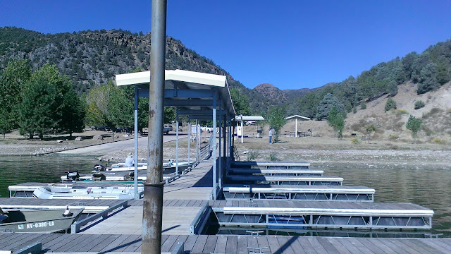 boating dock, hills, and trees