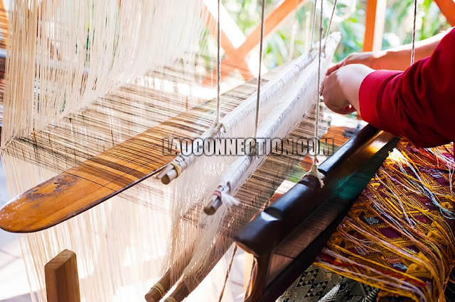 Weaving Lao textiles and fabrics on a loom