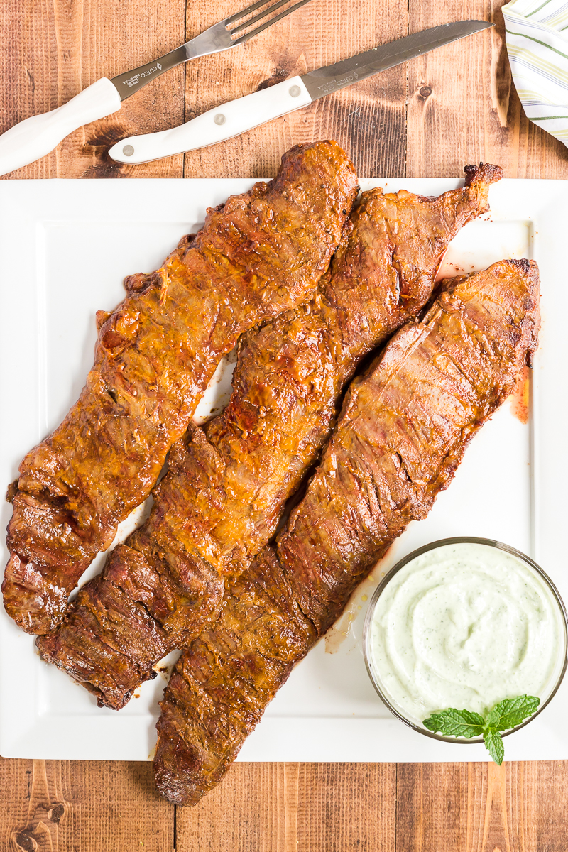This Grilled Tandoori Steak is an easy to prepare low carb dish the whole family will love. Skirt (or flank) steak in an Indian inspired tandoori marinade and grilled to perfection. #lowcarb #keto #beef #steak #Grilled #tandoori #indian #easy #recipe | bobbiskozykitchen.com