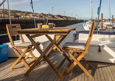 Photo of our table and chairs on Ravensdale's aft deck during the summer