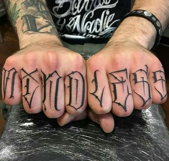 letters tattoo on finger