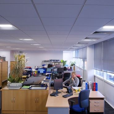 the old lighting comprised 1x58w switchstart luminaires with cat 2 louvres arranged in rows within a metal plank ceiling across the office space cat 2 office lighting