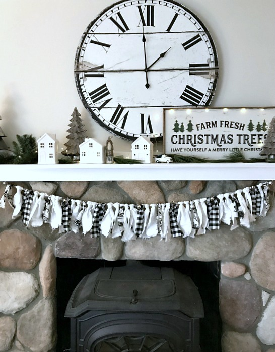 Black and white Christmas mantel with large clock