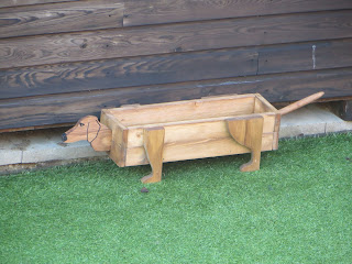 Hand carved Sausage Dog planter.