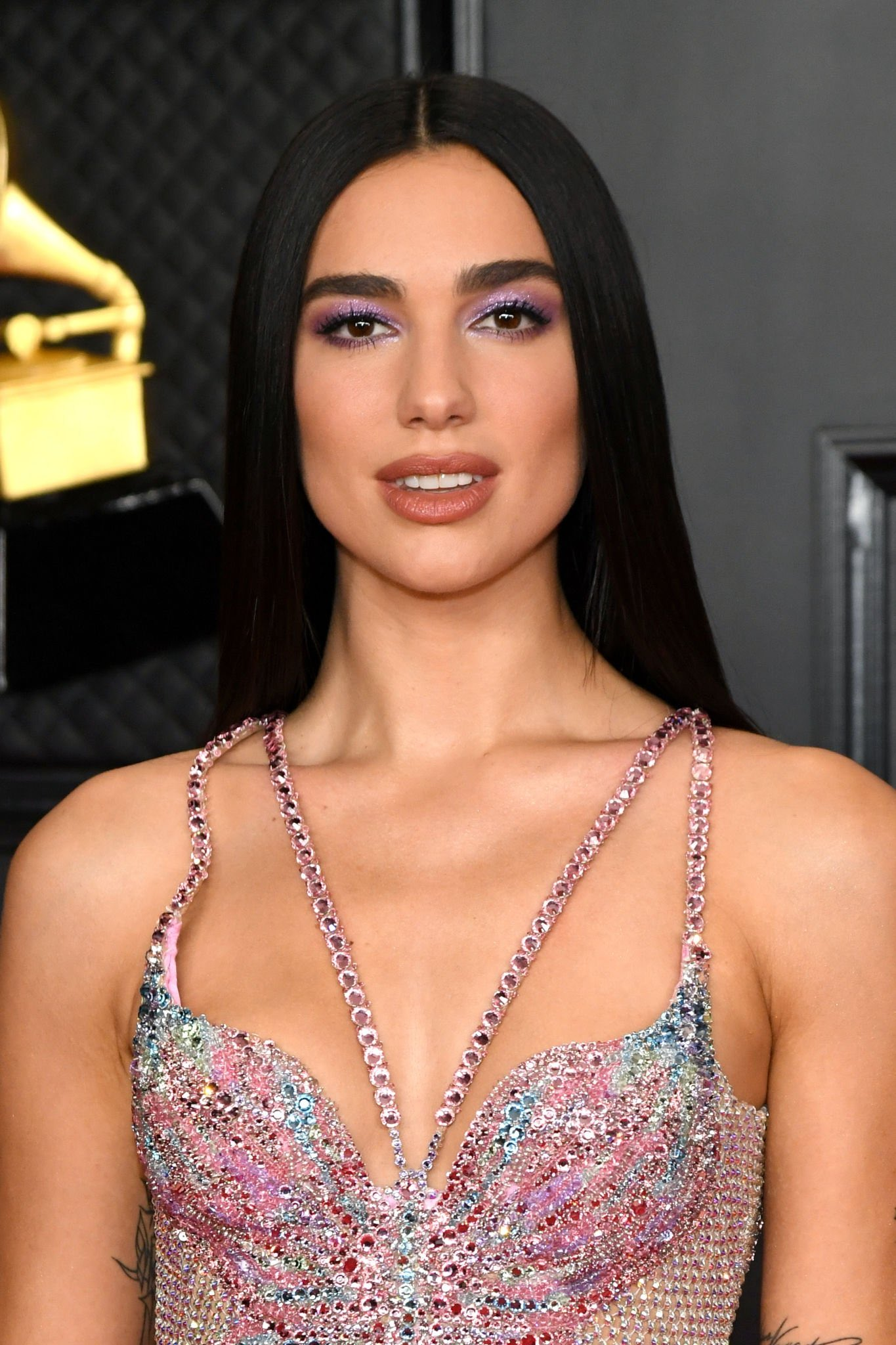 Sheer butterfly dress to bedazzled bikini set: Dua Lipa brings A-game to Grammys