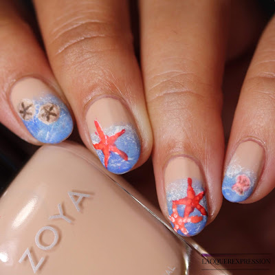 Free-handed hand painted summer beach nail art using nail polish