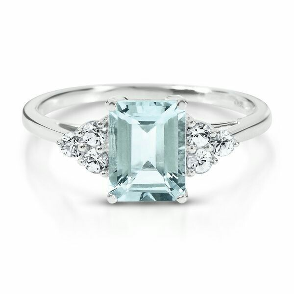 18K White Gold Ice Blue set with round cut brilliant ladies ring