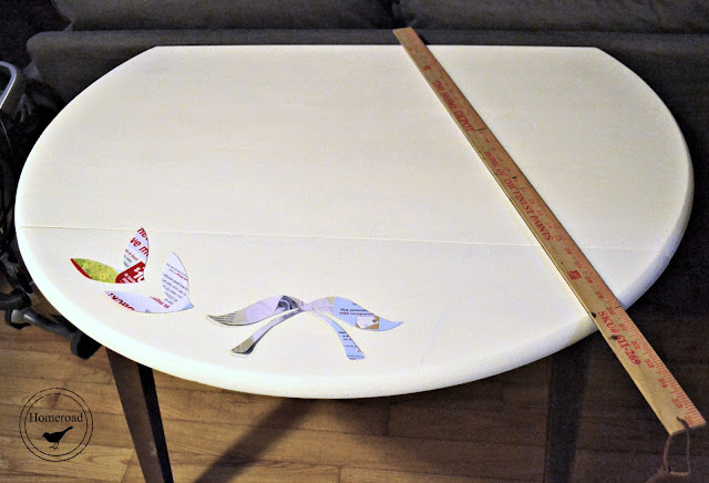 table with yard stick and cut outs