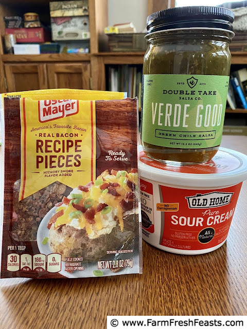 image of ingredients used to level up Instant Pot Meal Prep Breakfast Bowls--cooked bacon pieces, salsa, and sour cream