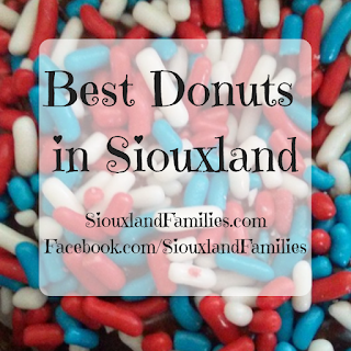 "in background, red white and blue sprinkles on a donut. in foreground, ""best donuts in siouxland"""