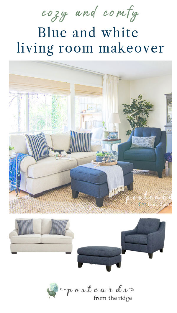 blue and white furniture in living room with large windows