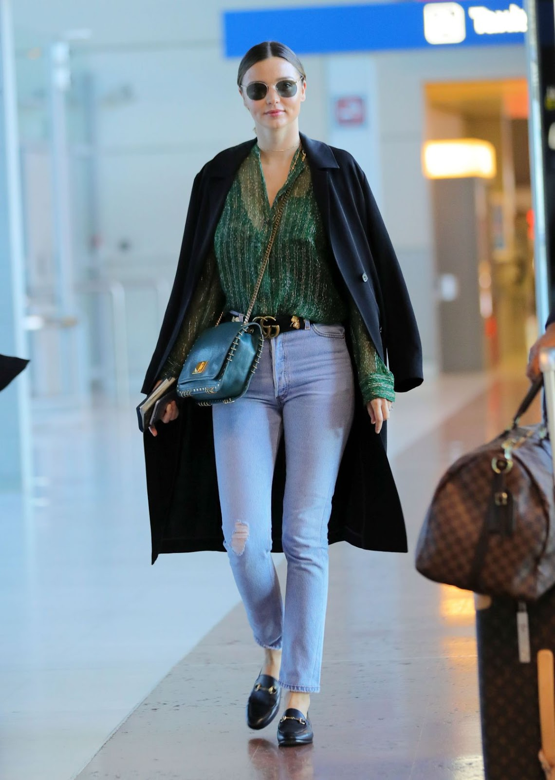 Miranda Kerr at CDG Airport