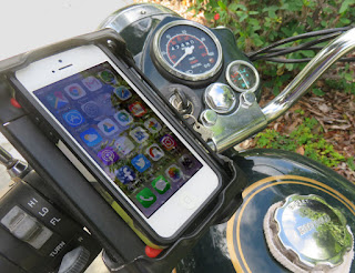 Smart phone is mounted on handlebar of motorcycle.