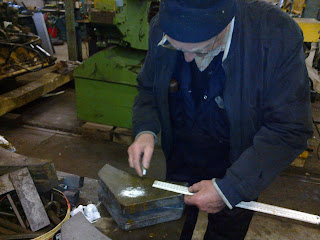 Ronnie marking out the new brake blocks for the Husky