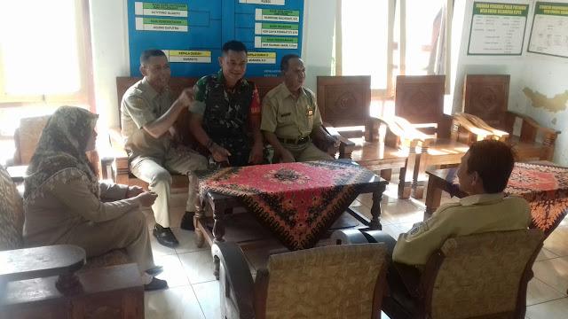 Babinsa berkordinasi kepada perangkat desa untuk adakan himbauan kepada masyarakat tentang virus Corona