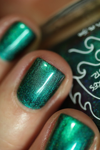 emerald green multichrome swatched on white person's nails