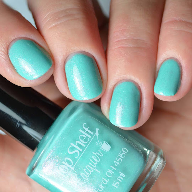 teal shimmer nail polish four finger swatch
