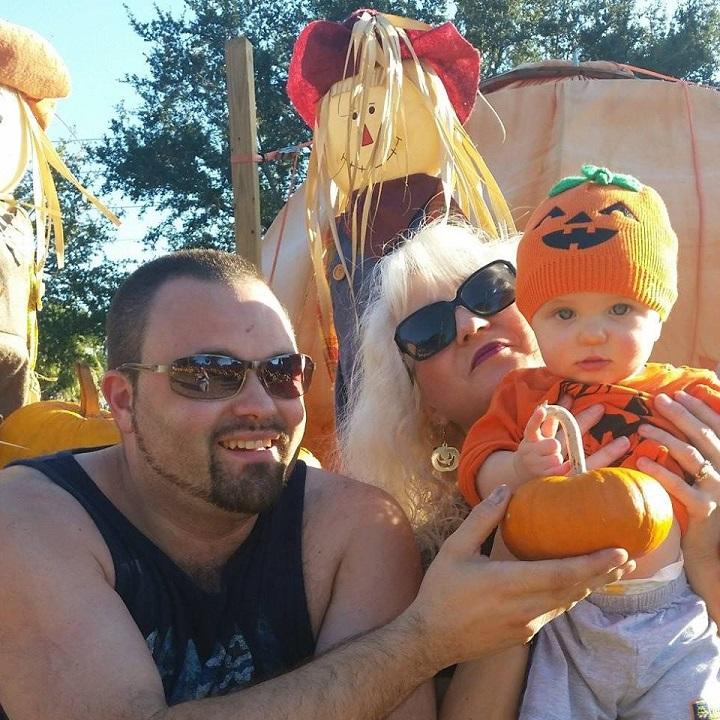 this is a photo of my grandson Antonio, son Curt and me at a pumpkin farm