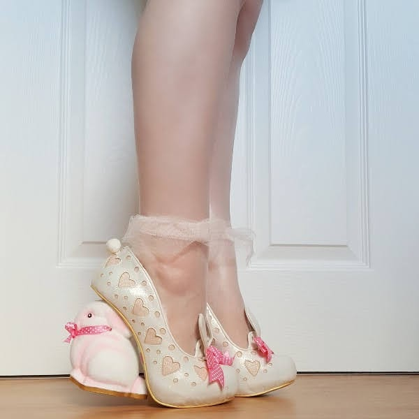 wearing bunny heeled shoes with glitter heart detail