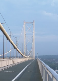 Mid-span view of a tower and cables of the Forth Road Bridge from the west side walkway, looking south; Queensferry, Scotland
